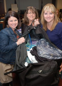 Among the WIRE volunteers for the 2014 Co-op Closet project were Kelli McDowell (left) Jessie Hendrick (right) of HEC's WIRE chapter and Denette Rimer (center) of Lexington-based Mid-Carolina Electric Cooperative. (PHOTO CREDIT: WALTER ALLREAD)