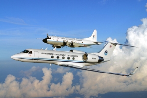 NOAA hurricane hunter WP-3D Orion and Gulfstream IV aircraft in flight. (Photo By: NOAA)