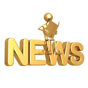 gold character sitting on the word 'news'